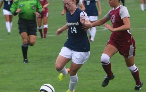 Women's soccer coach Dave Clarke says it takes a team to win