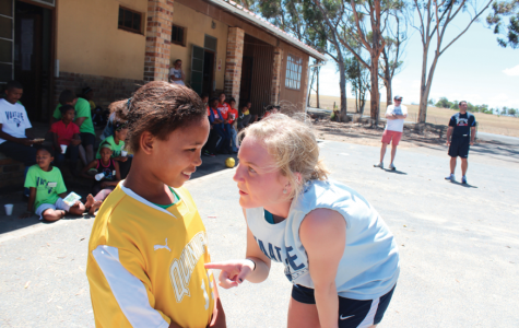 Soccer players and coaches travel to South Africa to share the game