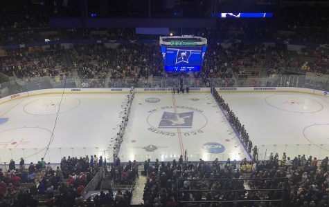 NCAA Hockey: Michigan defeats Northeastern, sets up Sunday meeting with BU