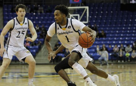 Young Scores 1,000th Point as Men's Basketball Cruises to Win over Saint Peter's